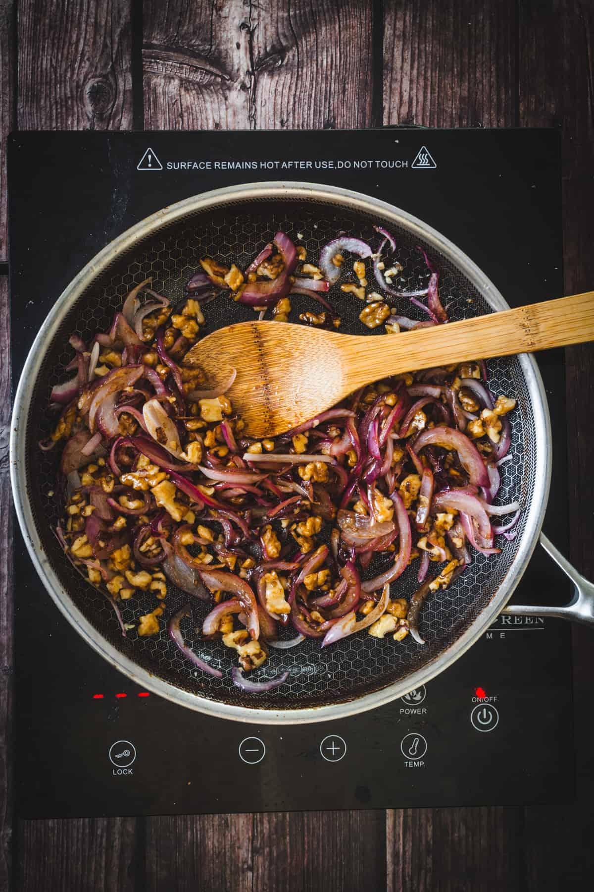 purple onions, walnuts sauteing in pan