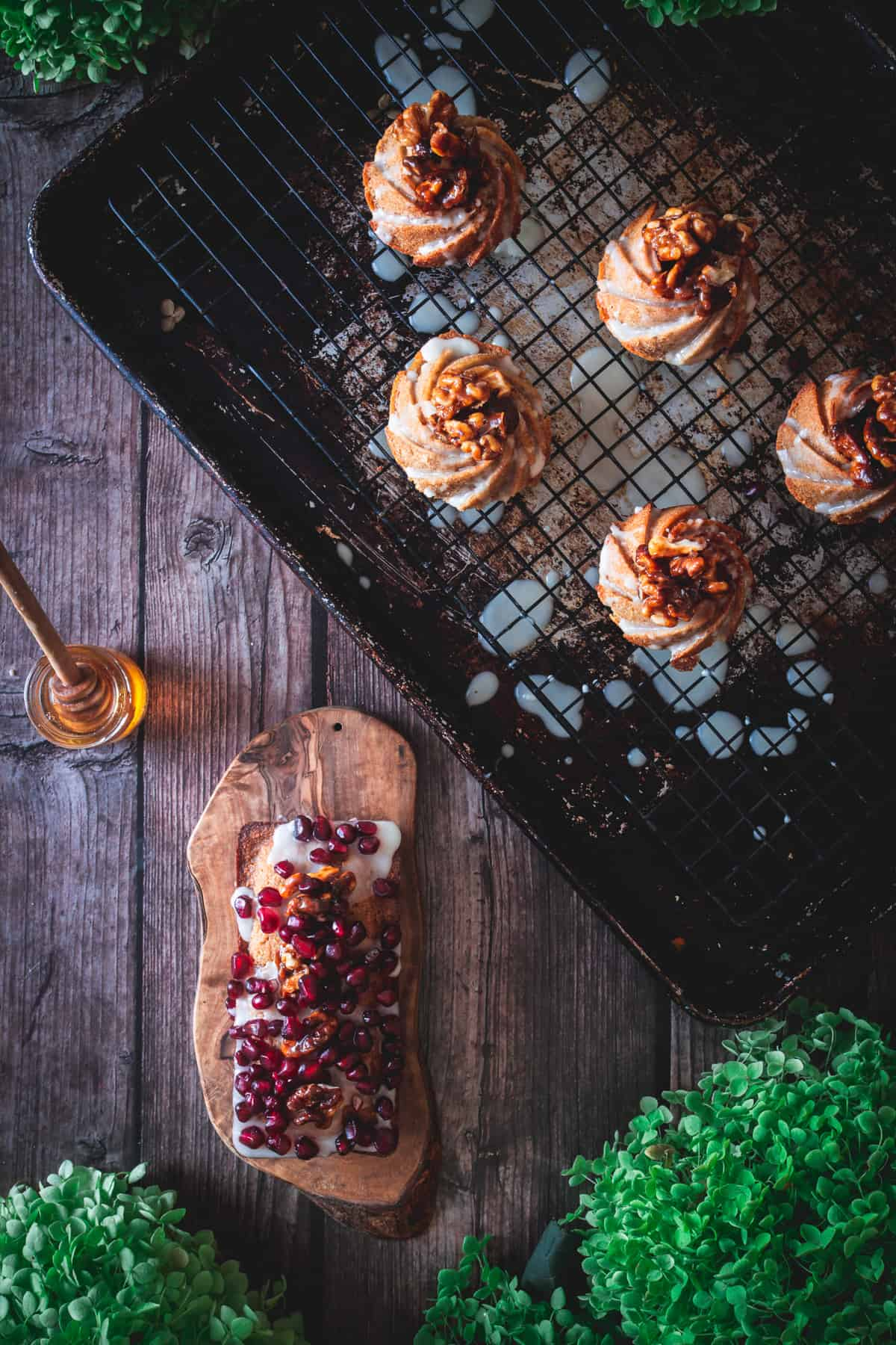loaf pan cake and mini honey cakes on baking sheet with honey